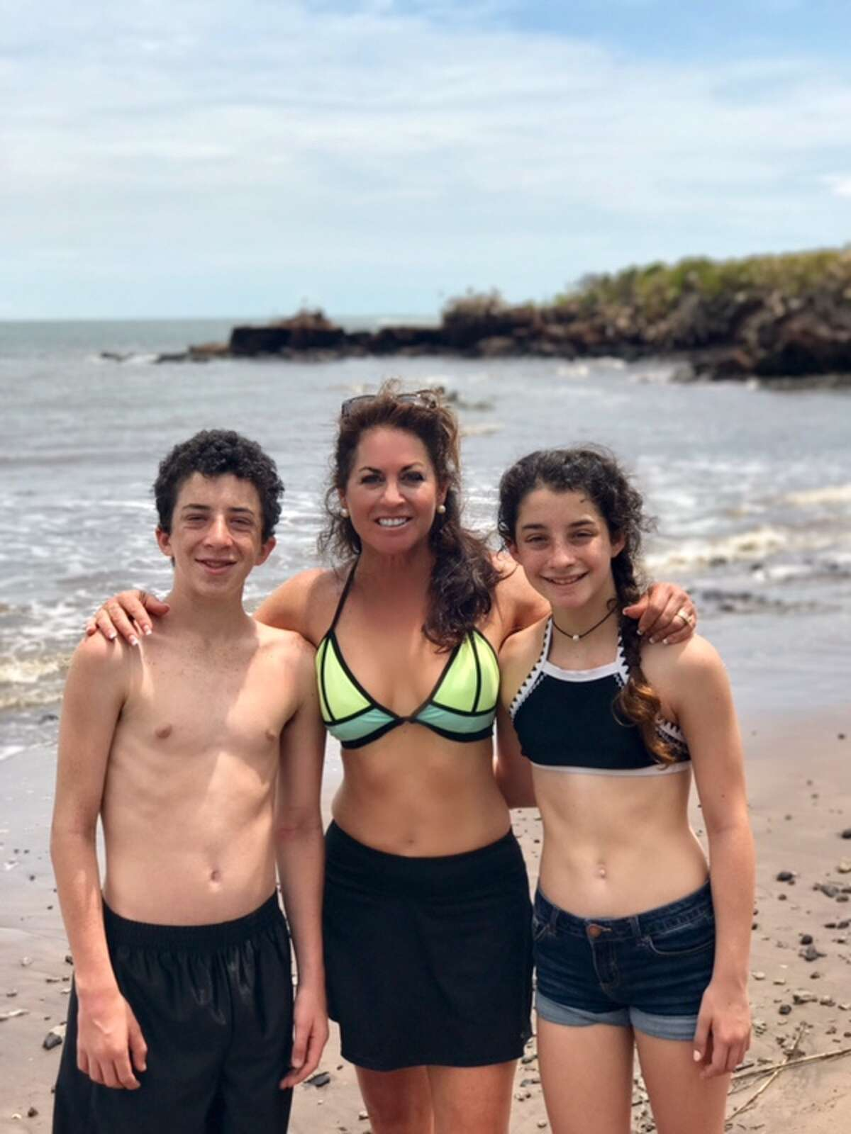 KSAT anchorwoman Ursula Pari stripped down to a bikini with her two children, Jackson and Georgia, during a June holiday in Jacksonville, Florida, where they hiked to their favorite secluded beach.