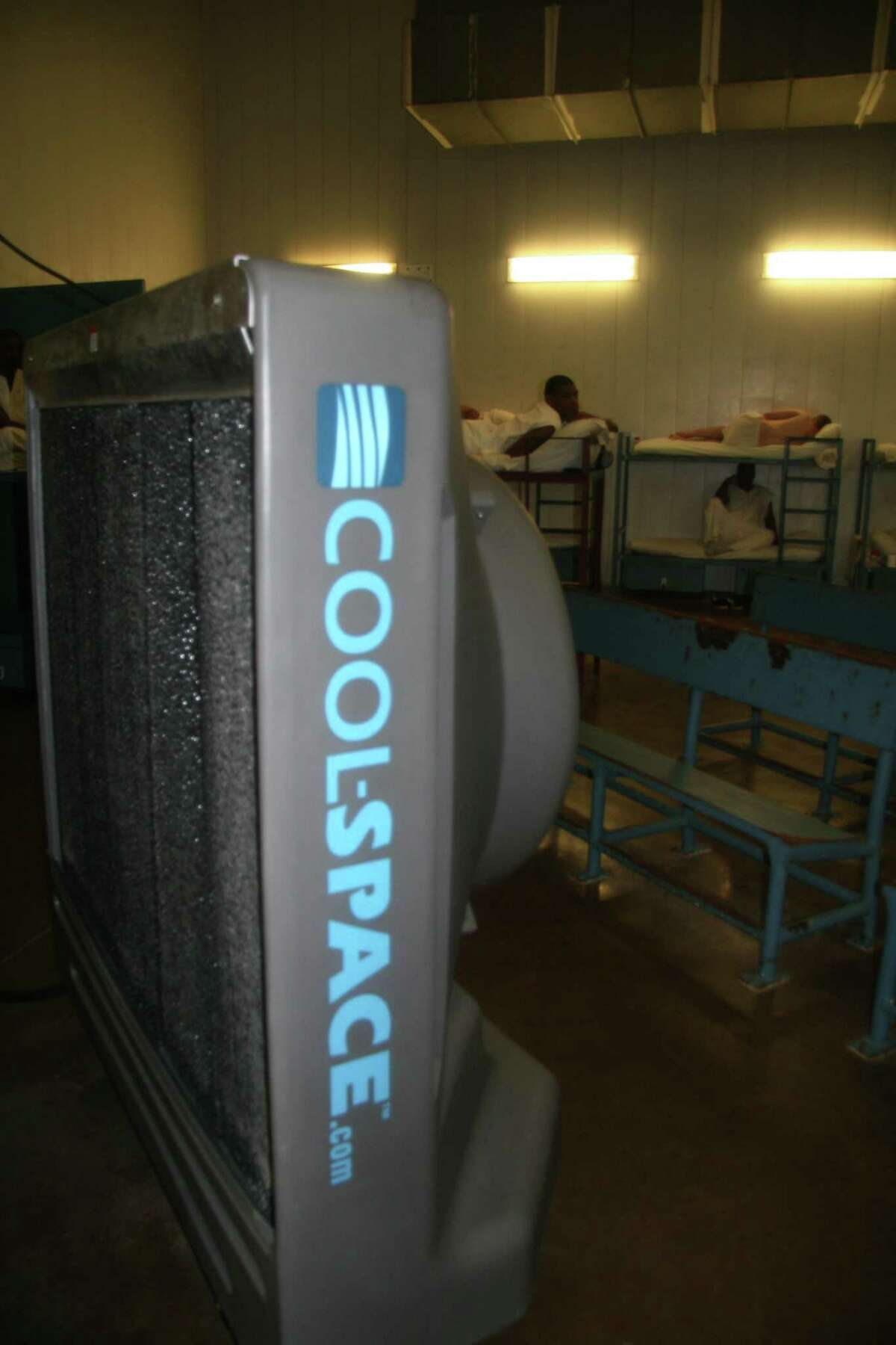 A cooling fan is installed at the Texas Department of Criminal Justice Holliday Unit near Huntsville. A federal lawsuit filed on behalf of inmates at the Pack Unit in Grimes County says Texas prison administrators are deliberately indifferent in exposing inmates to serious harm during summer heat waves.