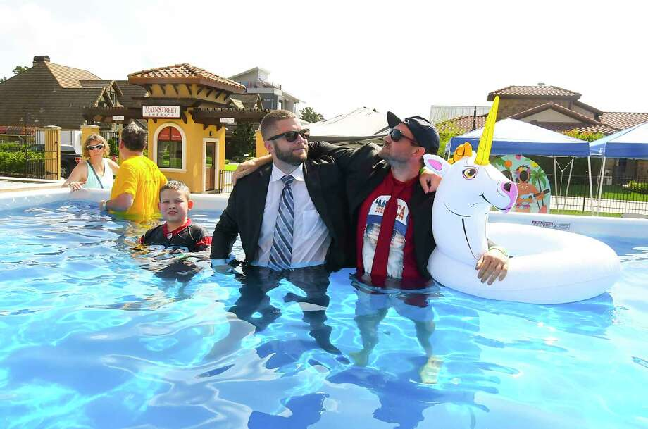 Business team of left Logan Hastings and Austin Jones raised money for Special Olympics and take the polar plunge. Residents gathered Saturday at Main Street America in Spring to take a dip in an ice-filled pool as part of a fundraiser for Special Olympics Texas. Photo: Tony Gaines, Photographer