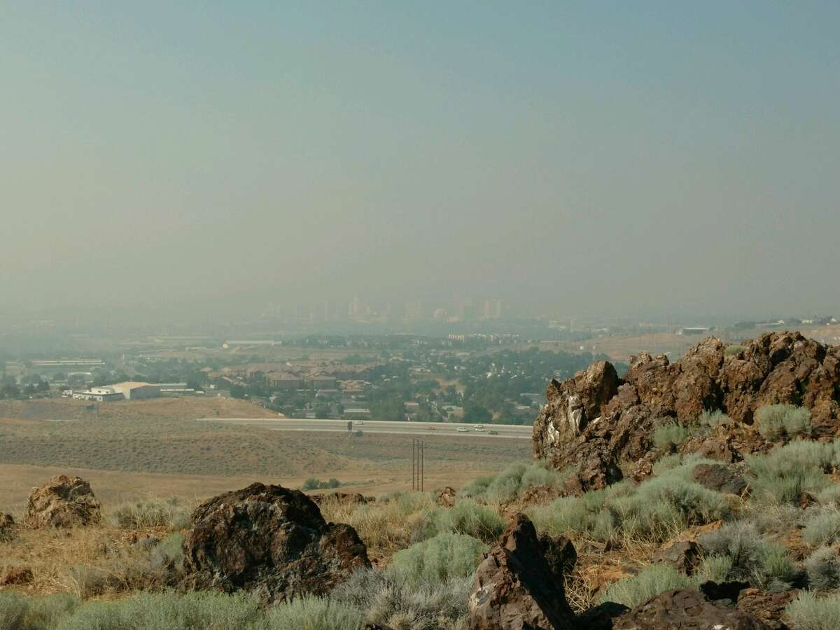 The air is hazy in Reno, Nev., from smoke blown in from the Detwiler Fire on July 19, 2017. In this photo of the downtown Reno skyline taken from the National Weather Service office on the outskirts of the city, you can barely see the buildings.