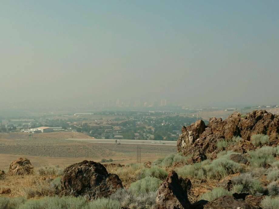 The air is hazy in Reno, Nev., from smoke blown in from the Detwiler Fire on July 19, 2017. In this photo of the downtown Reno skyline taken from the National Weather Service office on the outskirts of the city, you can barely see the buildings. Photo: Chris Johnston / National Weather Service
