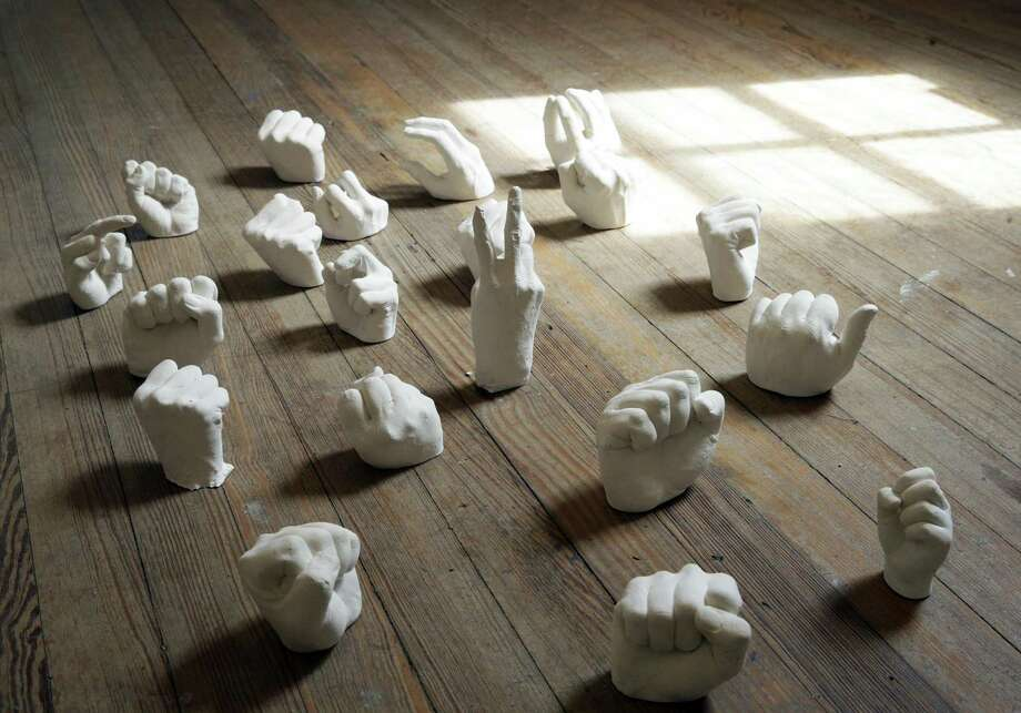 "Cast fists raised in protest by Jenelle Esparza are arranged on the floor as part of ""Weeds,"" an installation at Sala Diaz. Photo: Tom Reel /San Antonio Express-News / 2017 SAN ANTONIO EXPRESS-NEWS"