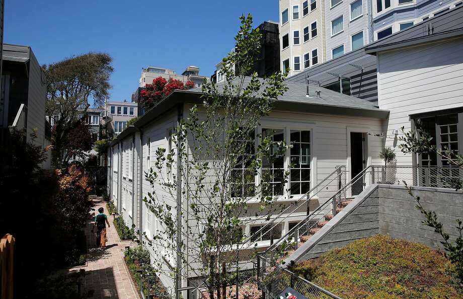 Above: Four cottages built in 1907 have been completely restored and now are on the market for $4 million and more. Below: The cottages in the 1300 block of Filbert Street on Russian Hill's west slope, as they appeared before the painstaking restoration. Photo: Michael Macor, The Chronicle