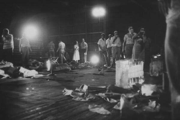 Hurricane Audrey's damage while relatives try to identify living survivors.
