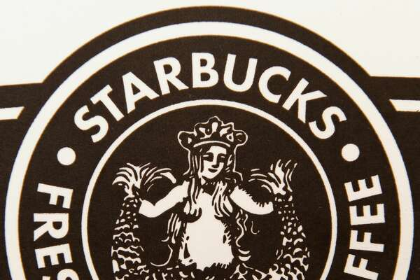 "The new Starbucks logo is pictured on a coffee cup May 16, 2008 in Washington, DC.  A Christian group based in San Diego, California calling itself The Resistance says in a press release the new image has a naked woman on it with her legs ""spead like a prositiute... and the company might as well call themselves Slutbucks."" The group is calling for a national boycott of the coffee-selling giant. The logo, similar to one the coffee chain used during its early days in the 1970s -- and which Starbucks maintains is not inappropriate -- is based on a 16th century Norse woodcut of a two-tailed mermaid.      AFP PHOTO / Paul J. RICHARDS (Photo credit should read PAUL J. RICHARDS/AFP/Getty Images)"