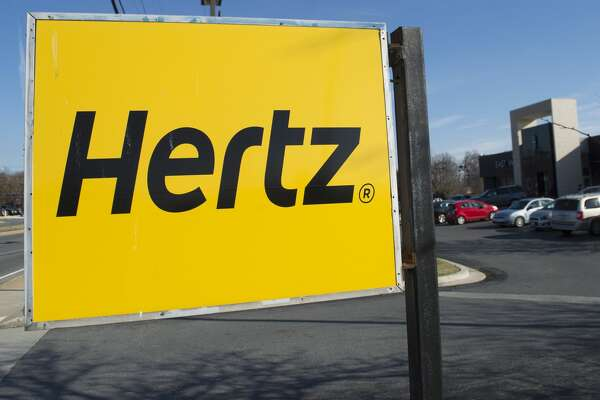 A Hertz car rental logo is seen in Landover Hills, Maryland, December 31, 2014. AFP PHOTO / SAUL LOEB        (Photo credit should read SAUL LOEB/AFP/Getty Images)