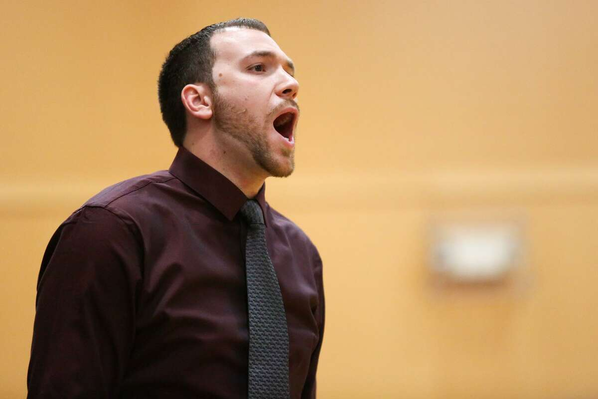 St. Lukes Head Coach Drew Gladstone yells to his players during St. Luke's victory over Rye Country Day School in New Canaan, Conn. on Tuesday, Feb. 14, 2107.