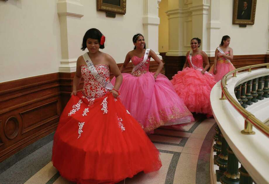 """Dressed as a Quice–eras, from left, Isabel Pierce, 11, Leslie Abraham, 21, Alexandra Lopez, 18, and Julia Pierce, 14, visit lawmakers at the State Capitol in protest against SB4, Wednesday, July 19, 2017. The bill known as the """"show me your papers,"""" will take effect on September 1st. The Quince–era is the coming of age for a girl in the Hispanic culture. Photo: Jerry Lara, San Antonio Express-News / San Antonio Express-News"""
