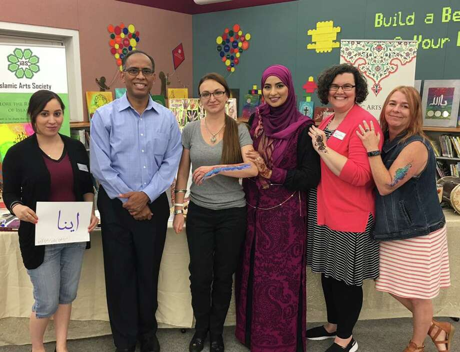 Islamic Arts Society partnered with Octavia Fields Library to host Islamic Art: Henna and Calligraphy that gave participants the opportunity to learn and practice how to apply Henna. Participants also learned about Calligraphy and browsed through a collection of Islamic artwork. Photo: Courtesy Photo