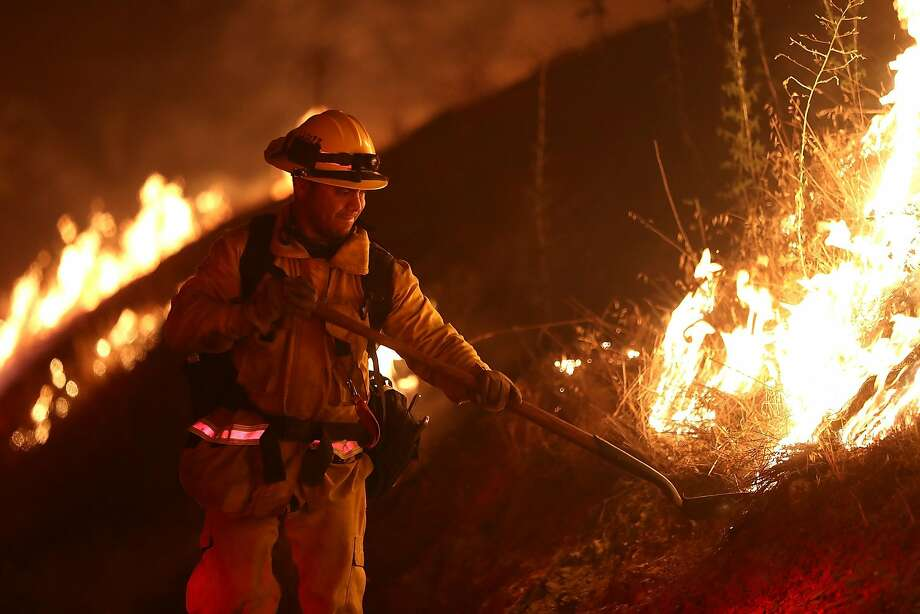 A Los Angeles County firefighter monitors the Detwiler Fire on Tuesday, July 18, 2017, in Mariposa, California. Photo: Justin Sullivan, Getty Images