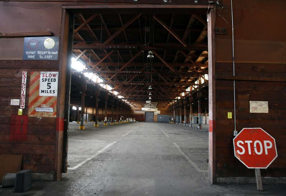 A warehouse on the former Oakland Army Base shown in 2009 was among the buildings slated for a redevelopment project that's now being investigated. Photo: Paul Chinn, The Chronicle