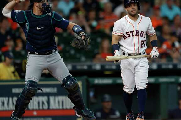 Houston Astros Jose Altuve (27) reacts after striking out during the first inning of an MLB baseball game at Minute Maid Park, Wednesday, July, 19, 2017.