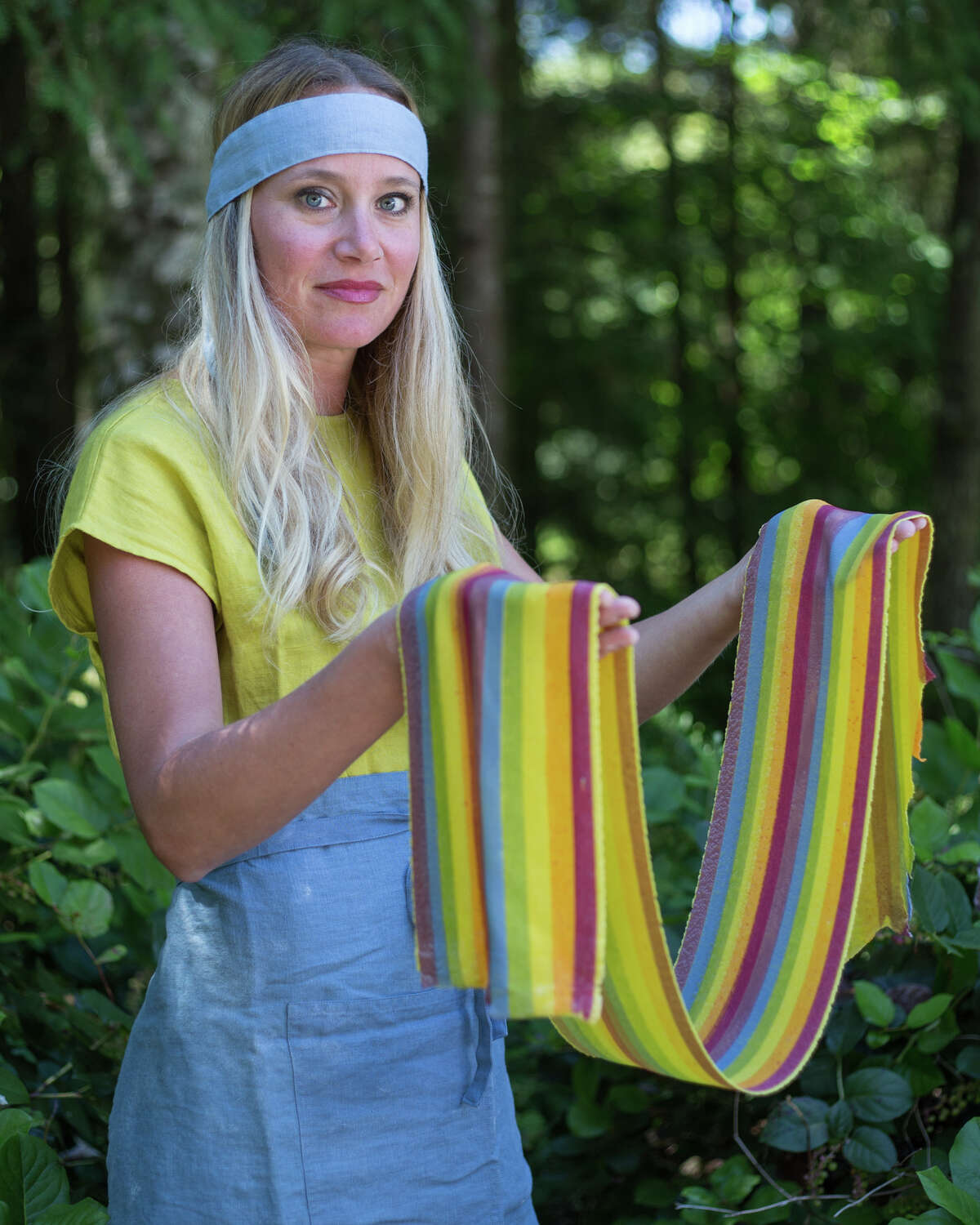 Linda Miller Nicholson poses with a long sheet of freshly made rainbow pasta at her home in Preston on Tuesday, July 18, 2017.