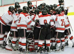 The New Canaan High School boys hockey team during the FCIAC boys ice hockey semifinal game between Greenwich High School and New Canaan High School at Terry Conners Rink in Stamford March 1.