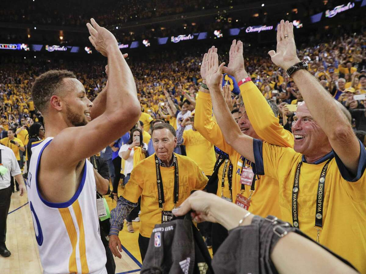 """FILE - Stephen Curry celebrates with fans at Oracle Arena after the Warriors won Game 5 of the NBA Finals against Cleveland to regain the NBA championship in this file photo. The Warriors' Oracle Arena has been dubbed """"Roaracle Arena"""" for how loudly the fans cheer their team on."""