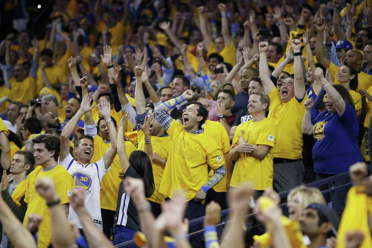 FILE - Fans react in the final minutes of Game 5 of the NBA Finals between the Golden State Warriors and the Cleveland Cavaliers at Oracle Arena in Oakland in this file photo from Monday, June 12, 2017. The Warriors received the Best Home Court Advantage Award from the NBA Players Association on Friday.