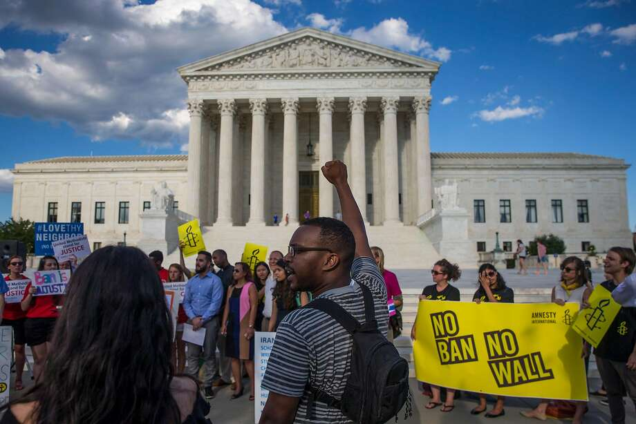 Protesters rally last month outside the Supreme Court after it announced it would hear arguments on the president's travel ban. Photo: AL DRAGO, NYT