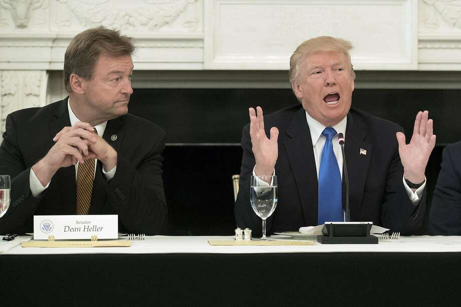 Nevada Sen. Dean Heller (left) was singled out during President Trump's arm-twisting session at the White House. Photo: Michael Reynolds, Bloomberg