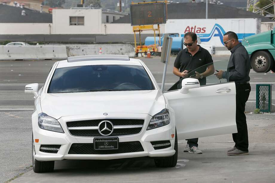 f8c6153ee8 TravelCar general manager Dre Sharma (right) helps a customer Omer T.(left
