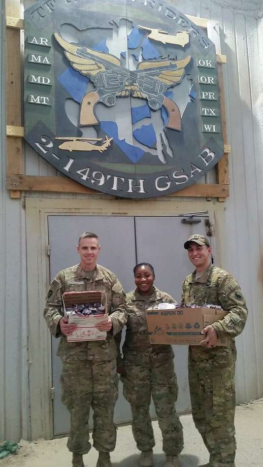 Jessie Guajardo, right, received 500 individual barbecue sauce packets from his hometown Chick-Fil-A after asking the restaurant for some help making his meals in Iraq taste better. Photo: Jessie Guajardo