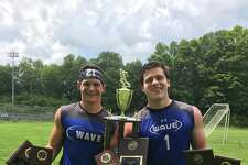 Darien's Mitch Pryor and Mike Neary hold Darien football's awards after winning the Berlin Lineman Challenge for the fourth straight year.
