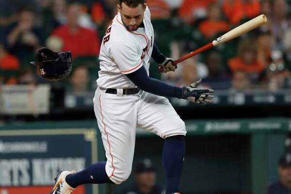 Houston Astros George Springer loses his helmet after swinging at a pitch during the third inning of an MLB baseball game at Minute Maid Park, Wednesday, July, 19, 2017.