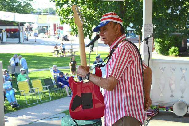 Charlies Salerno, longtime co-leader of The Clam Diggers, prepares for their show at the Sherman Green Gazebo, Sunday, July 16, 2017, in Fairfield, Conn.