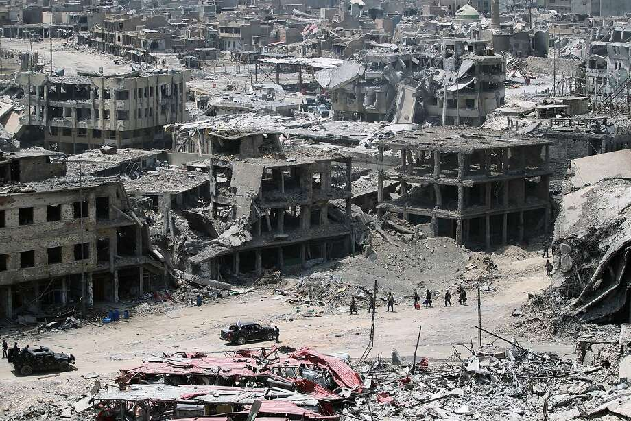 Iraqi troops walk amid the destruction in Mosul's Old City. Military victories in the former Islamic State group's stronghold are fueling extrajudicial killings by government forces. Photo: AHMAD AL-RUBAYE, AFP/Getty Images
