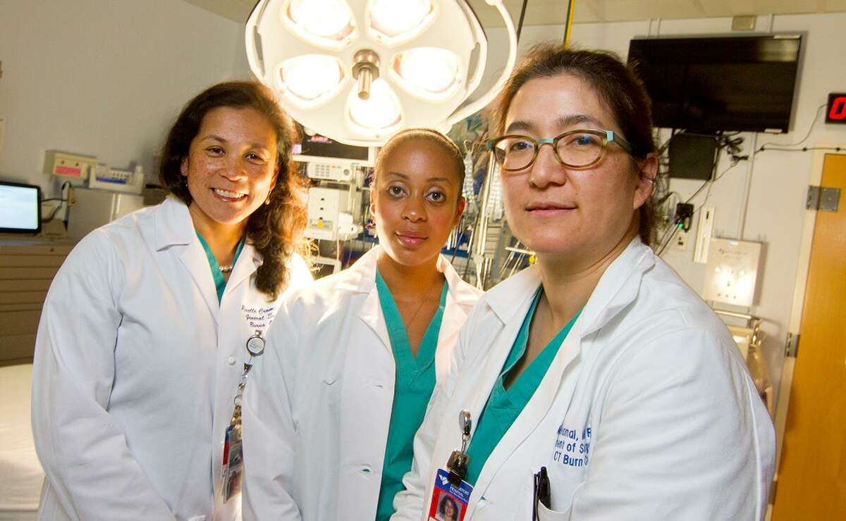 Hospitals are trying to bridge a gender gap when it comes to female surgeons. Photographed in a Bridgeport Hospital emergency room are from left surgeons: Dr. Roselle Crombie, Dr. Kristen Glasgow, and Dr. Alisa Savetamal, who is also medical director of the Connecticut Burn Center at Bridgeport Hospital, the state?'s only dedicated burn care facility.