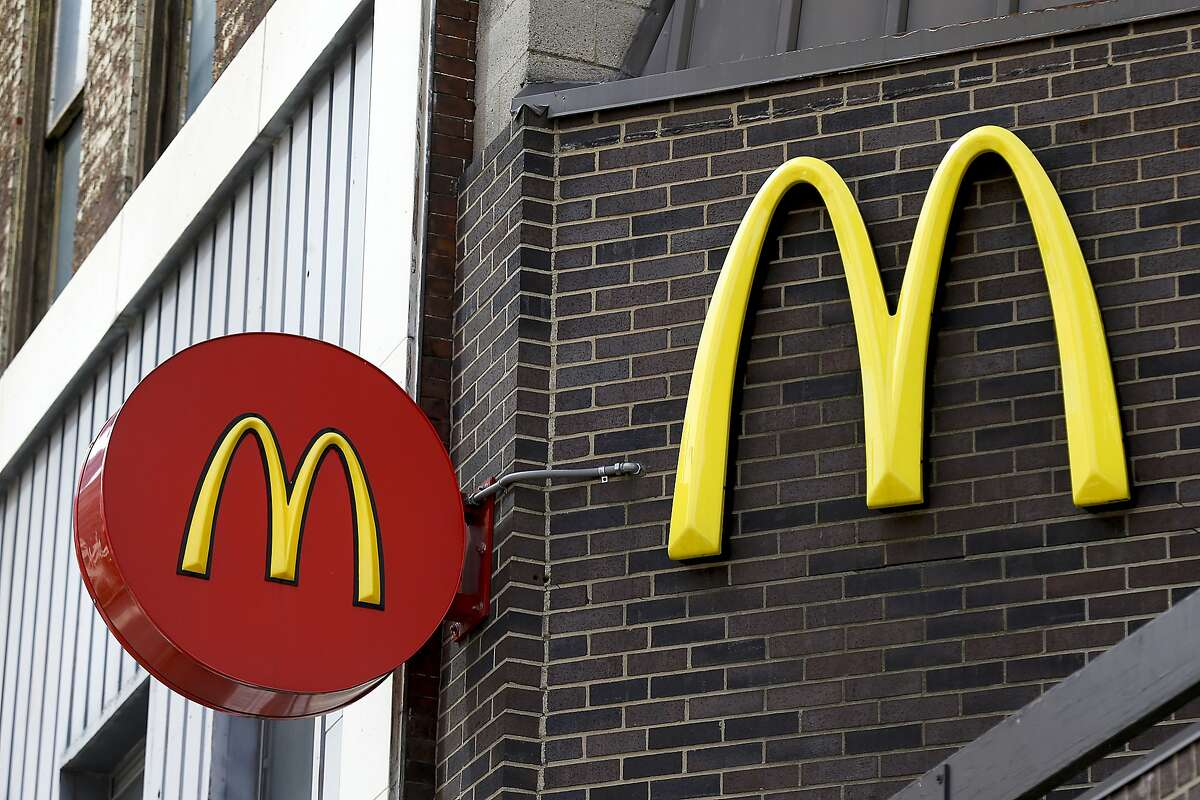 FILE - In this April 24, 2017, file photo, corporate signage hangs at a McDonald's restaurant in downtown Pittsburgh. A McDonald�s promotion for free ice cream cones to celebrate National Ice Cream Day on July 16, 2017, went awry over a glitch with the fast food giant�s mobile app. (AP Photo/Keith Srakocic, File)
