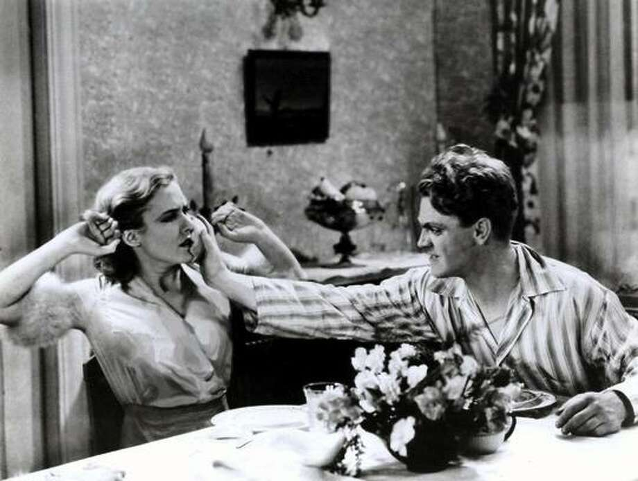 """James Cagney bullies Mae Clarke at breakfast in """"The Public Enemy."""""""
