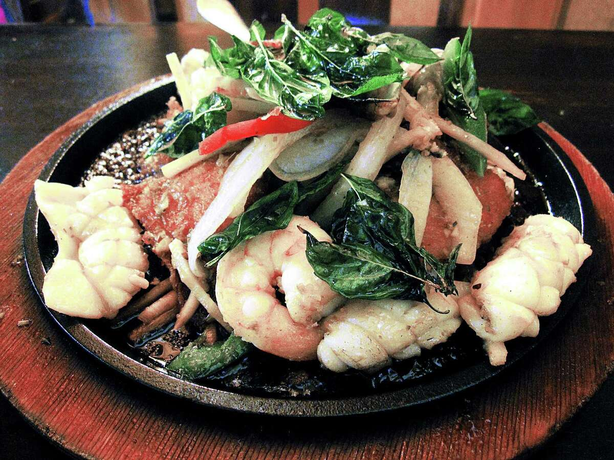 A sizzling platter of seafood -- squid, mussels, shrimp and and an add-on of fried tilapia -- called Angry Ocean from Thai Dee.