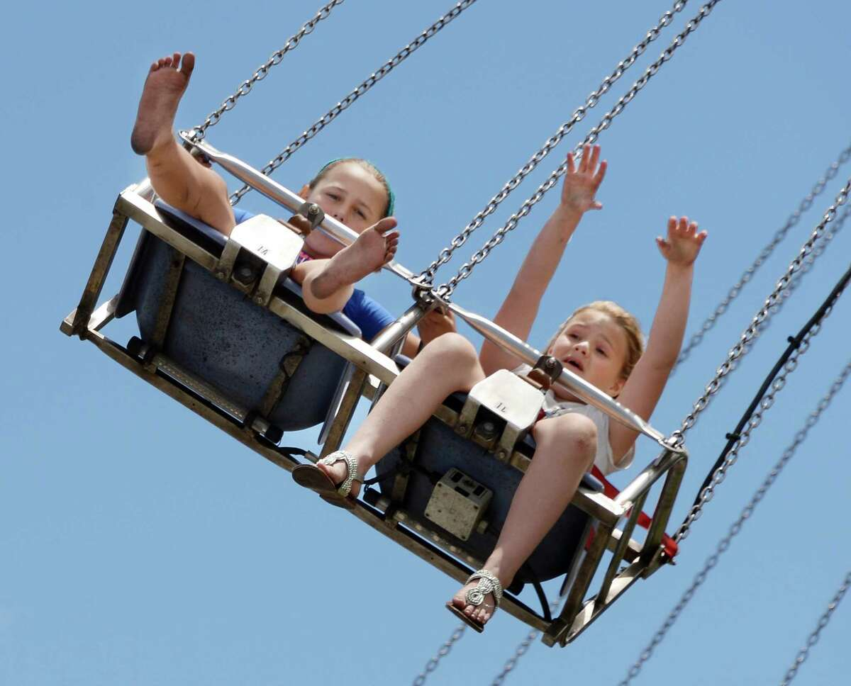 Georgia Gonzalez, left, 8, and Rebecca James, 9, on the Vertigo ride during opening day at the Saratoga County Fair Tuesday July 19, 2016 in Ballston Spa, NY. (John Carl D'Annibale / Times Union)