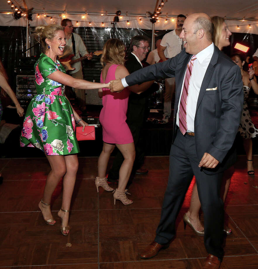 Saratoga Springs, NY - July 24, 2015 - (Photo by Joe Putrock/Special to the Times Union) - Kelly Springer(left) and Greg Ripich(right) prove they know their way around a dance floor during the 65 Roses Opening Day Soiree honoring the Golub Family, a benefit for the Cystic Fibrosis Foundation of Northeastern NY, held at Fasig Tipton in Saratoga Springs. ORG XMIT: 03 Photo: Joe Putrock / Joe Putrock