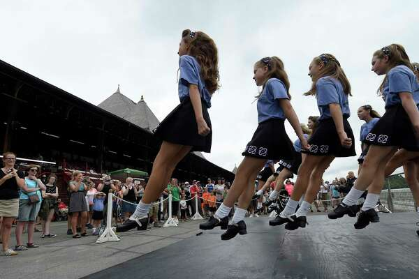 The Boland School of Irish Dance step dances away for the crowd on Irish Day at the Saratoga Race Course Wednesday, Aug. 10, 2016, in Saratoga Springs, N.Y.   (Skip Dickstein/Times Union)