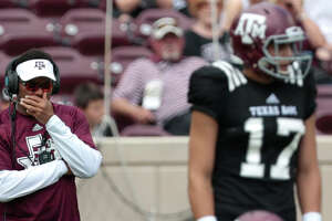 Texas A&M fans head coach Kevin Sumlin watches his offense line up for a play during the Texas A&M spring football game at Kyle Field on Saturday, April 8, 2017, in College Station. ( Brett Coomer / Houston Chronicle )