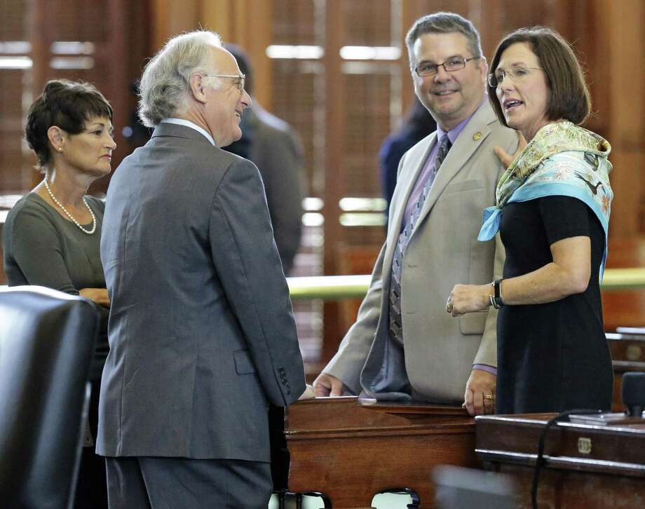 "Sen. Lois Kolkhorst (right), original sponsor of the ""bathroom bill,"" chats with colleagues on the floor of the Senate on Thursday. From left are Sens. Donna Campbell, Kirk Watson and Charles Perry. The Texas Senate has set a public hearing for 9 a.m. Friday to hear from people about the newly filed Senate Bill 3, filed by Kolkhorst. Photo: Tom Reel /San Antonio Express-News / 2017 SAN ANTONIO EXPRESS-NEWS"