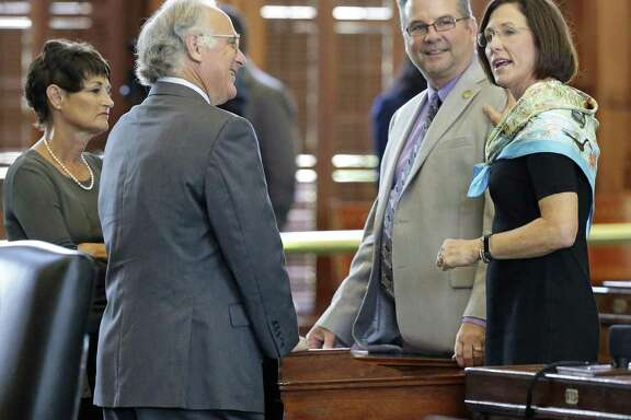 """Sen. Lois Kolkhorst (right), original sponsor of the """"bathroom bill,"""" chats with colleagues on the floor of the Senate on Thursday. From left are Sens. Donna Campbell, Kirk Watson and Charles Perry. The Texas Senate has set a public hearing for 9 a.m. Friday to hear from people about the newly filed Senate Bill 3, filed by Kolkhorst."""