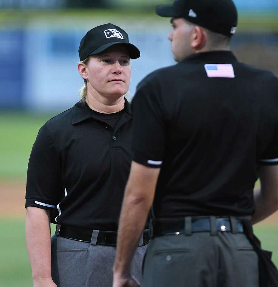 7f3e10cc196 Umpire Jennifer Pawol talks to another umpire before a Tri-City ValleyCats  baseball game against