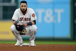 Houston Astros shortstop Marwin Gonzalez (9) sits on second base during a challenged play during the sixth inning of an MLB baseball game at Minute Maid Park, Wednesday, July, 19, 2017. ( Karen Warren / Houston Chronicle )
