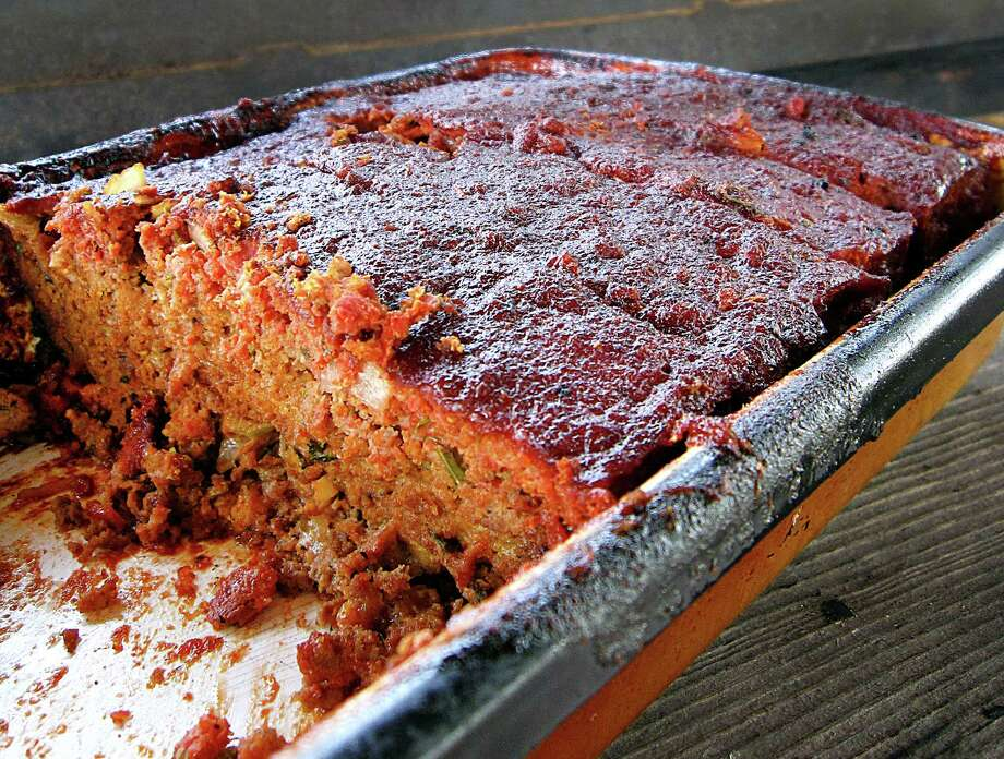 This recipe for Aunt Debbie's Smoked Meatloaf can be made in the oven or a barbecue smoker. It combines brisket, pork, sirloin and bacon with a spicy tomato and brown sugar topping. From staff writer Mike Sutter for the Taste team's Loaf Off. Photo: Mike Sutter, San Antonio Express-News