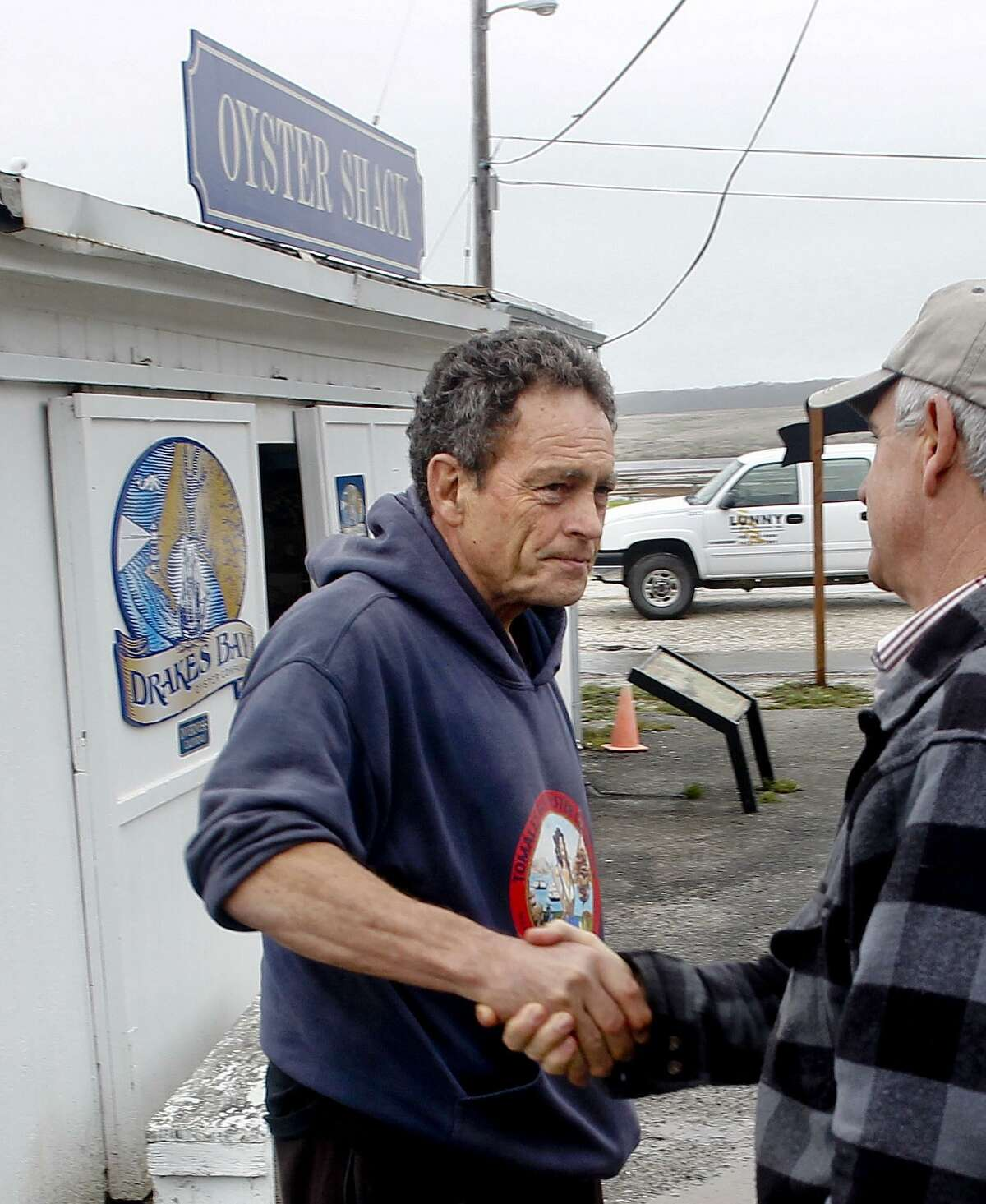 """Charles """"Tod"""" Friend, left, the owner of Tomales Bay Oyster Co., is seen in a file photo."""
