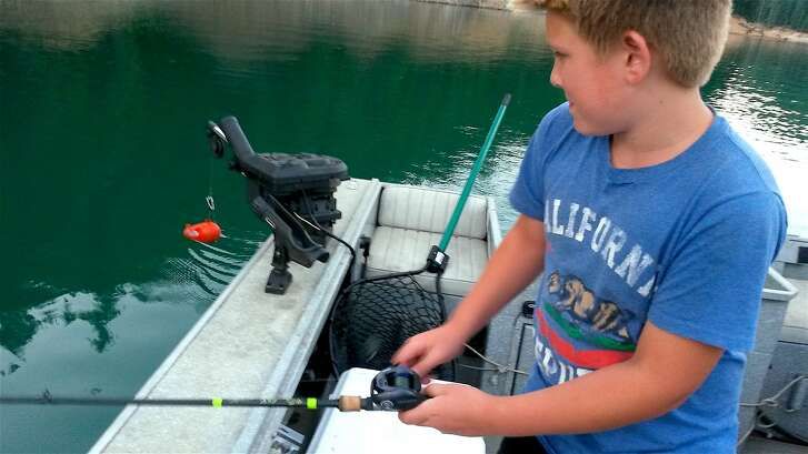 Jacob Chapman fighting a trout he hooked himself on an outing this past week where he went swimming, had a picnic, watched wildlife and caught fish