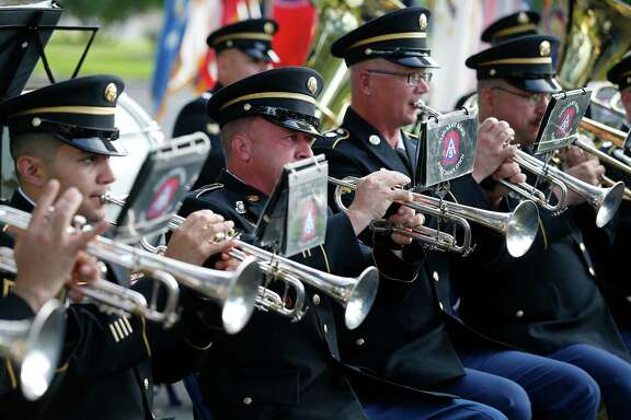 The 323rd Army Band performs during a retirement ceremony last month at Fort Sam Houston. Band supporters say the groups raise soldier morale and bridge the gap between civilians and the military. (Kin Man Hui / San Antonio Express-News)