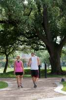 A couple strolls along the walking path at Baldwin Park on Elgin in Midtown. (Photo By R. Clayton McKee)