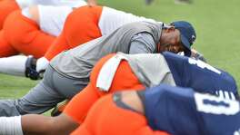 UTSA coach Frank Wilson jokes with his players during spring practice on April 10, 2017.