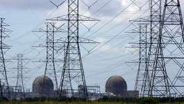 The South Texas Project nuclear generating is seen behind transmission lines. A rise in attempted cyberattacks has led to further warnings that power utilities could be at risk for infiltration and attack.