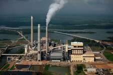 CPS Energy's Spruce 2 (center smoke stack closest to camera) coal-fired plant is a polluter and isn't efficient, a recent study concluded.