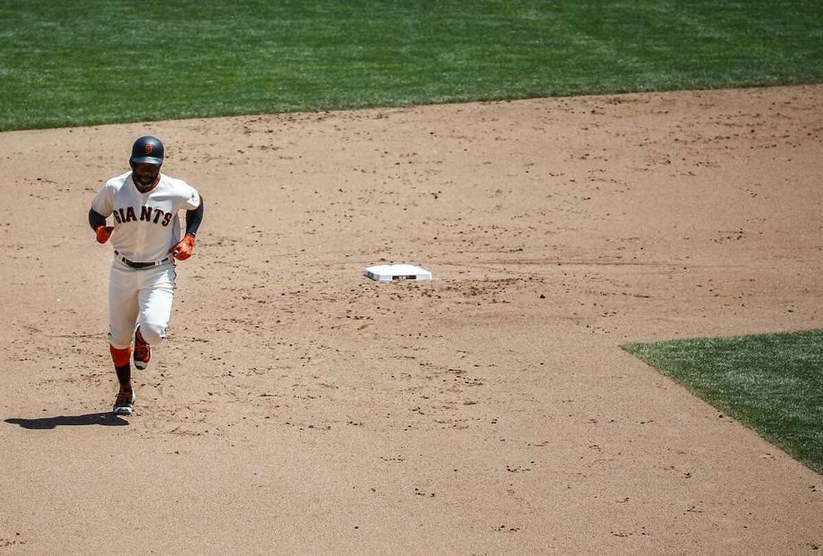 Giants outfielder Denard Span (2) rounds second base during the Giants' 5-4 win over the Indians on Wednesday.