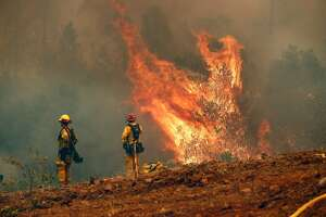 Firefighters with Cal Fire continue to battle the Detwiler Fire on the outskirts of Mariposa, Ca., on Wednesday July 19, 2017.